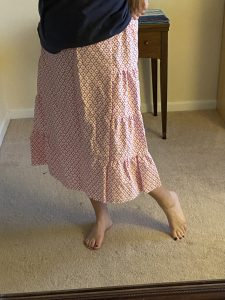 Image of person from waist down wearing a dress made from a sheet